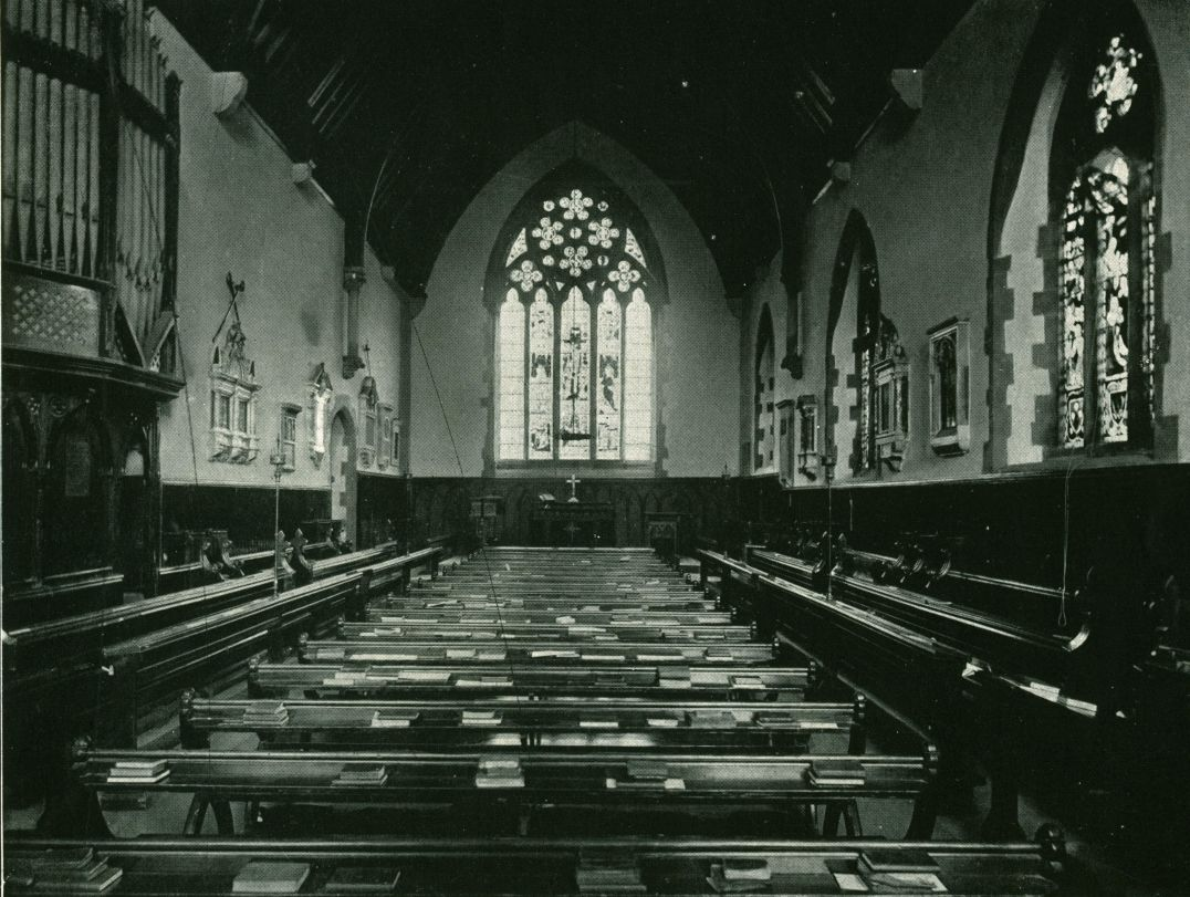 The Chapel interior in 1904. By 1911 the seating facing towards the East had been removed, and replaced with benches similar to those in place today